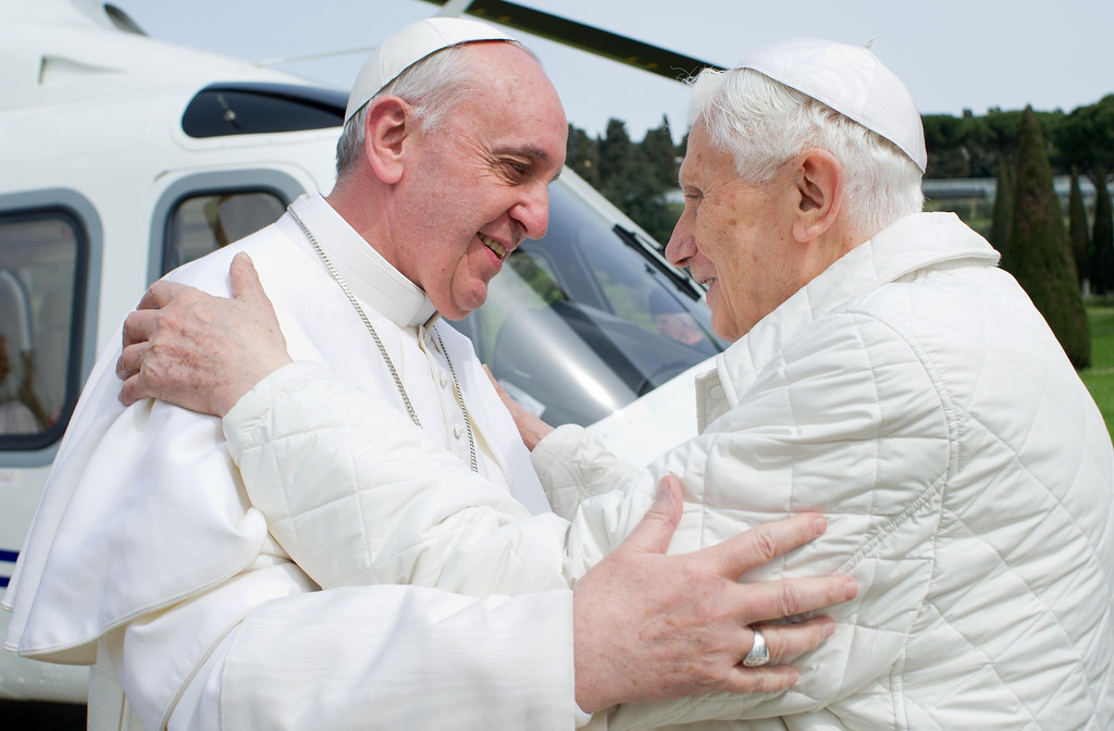 "Description of . ""Pope emeritus\"" Benedict XVI (R) greets Pope Francis upon his arrival at the heliport in Castel Gandolfo on March 23, 2013. Pope Francis prepared to go face to face with his predecessor Benedict XVI in a historic meeting between two men with very different styles but important core similarities.   OSSERVATORE ROMANO/AFP/Getty Images"