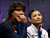 Yuko Kavaguti (R) and Alexander Smirnov of Russia watch their score after they performed their free skating program at the ISU World Figure Skating Championships in London, March 15, 2013.   REUTERS/Mark Blinch