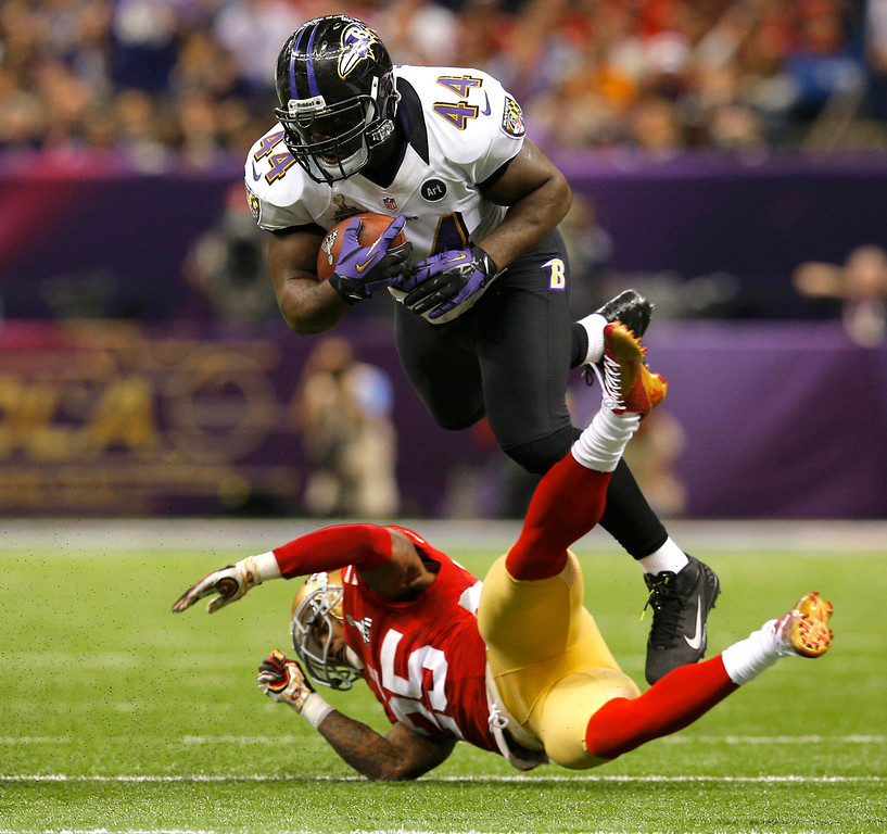 Description of . Baltimore Ravens fullback Vonta Leach (44) collides with San Francisco 49ers cornerback Tarell Brown (25) during the second quarter of the NFL Super Bowl XLVII football game in New Orleans, Louisiana, February 3, 2013. REUTERS/Brian Snyder