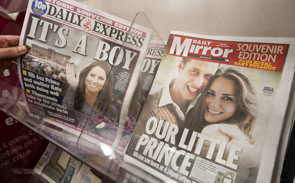 Description of . Newspaper front pages report news of the birth of a new royal baby in London on July 23, 2013. International messages of congratulations poured in for the Duke and Duchess of Cambridge following the birth of the third in line to the throne, celebrated by gunfire salutes across London. AFP PHOTO / WILL OLIVER/AFP/Getty Images