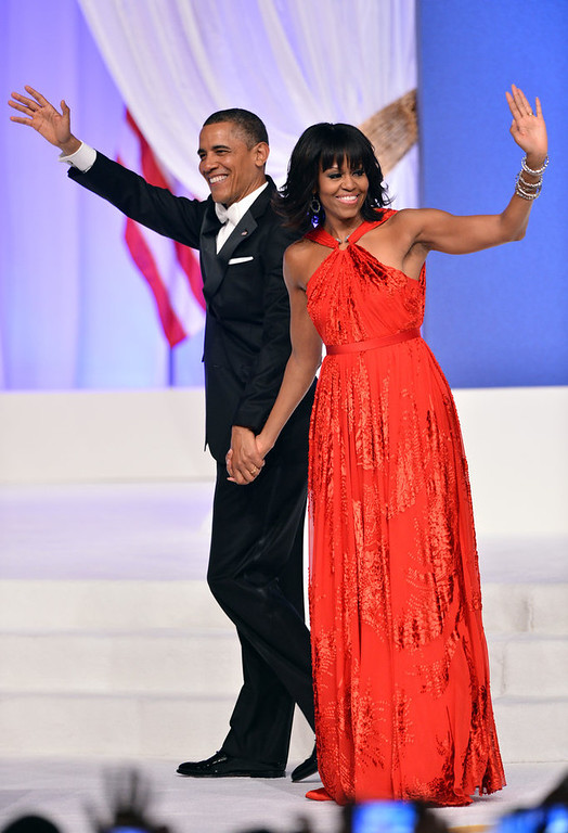Description of . US President Barack Obama and First Lady Michelle Obama attend the Commander-in-Chief's Ball, honoring US service members and their families, at the Walter E. Washington Convention Center on January 21, 2013 in Washington, DC.  JEWEL SAMAD/AFP/Getty Images