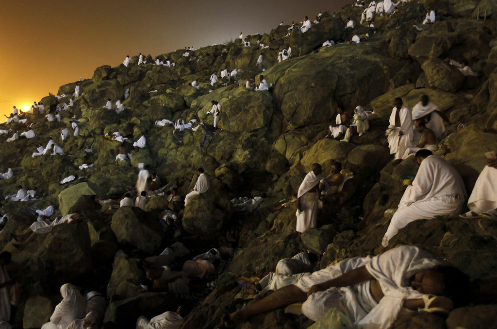 Description of . Muslim pilgrims sit on Mount Mercy on the plains of Arafat in the early morning during the annual haj pilgrimage near the holy city of Mecca October 25, 2012. Nearly 3 million Muslim pilgrims started the first phase of the annual haj on Wednesday, travelling through packed streets from Mecca's Grand Mosque to the enormous camp at Mina just outside the Saudi Arabian city. REUTERS/Amr Abdallah Dalsh