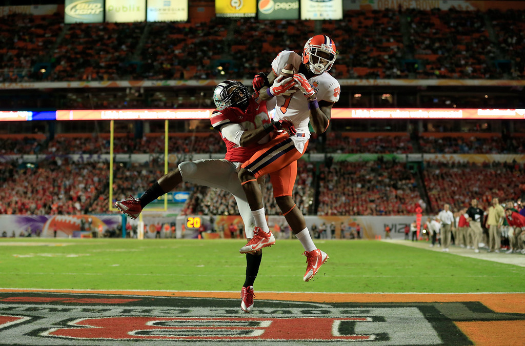 Description of . MIAMI GARDENS, FL - JANUARY 03:  Martavis Bryant #1 of the Clemson Tigers catches a touchdown against Armani Reeves #26 of the Ohio State Buckeyes in the second quarter during the Discover Orange Bowl at Sun Life Stadium on January 3, 2014 in Miami Gardens, Florida.  (Photo by Chris Trotman/Getty Images)