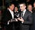 Colin Farrell admires Terrence Howard's gloves at the world premiere of 
