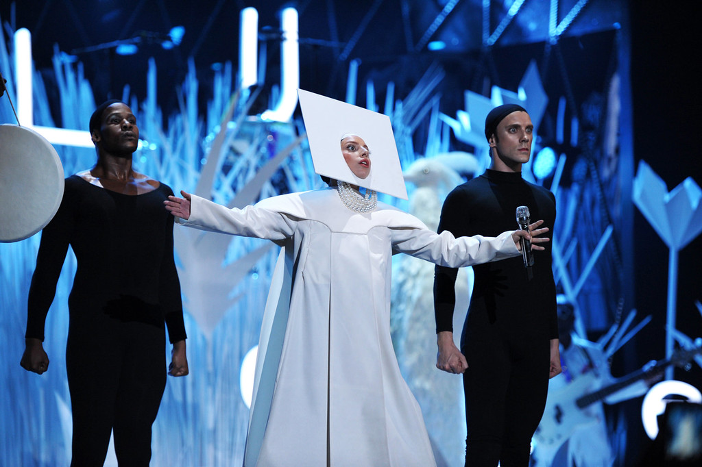 Description of . Lady Gaga performing at the MTV Video Music Awards at Barclays Center on Sunday, Aug. 25, 2013, in the Brooklyn borough of New York. (AP Photo/MTV, John Shearer)