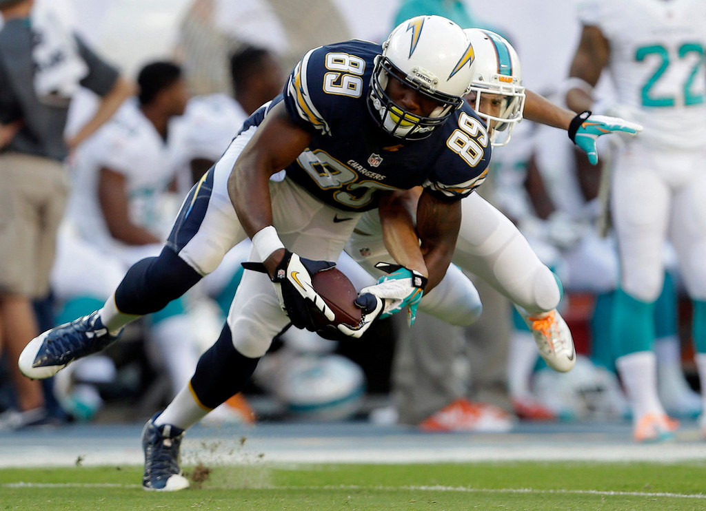 Description of . San Diego Chargers tight end Ladarius Green (89) grabs a pass over Miami Dolphins cornerback Brent Grimes during the first half of an NFL football game Sunday, Nov. 17, 2013, in Miami Gardens, Fla. (AP Photo/Lynne Sladky)