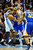 Golden State Warriors power forward Carl Landry (7) is pressured by Denver Nuggets center Kosta Koufos (41) and small forward Kenneth Faried (35) during the first half at the Pepsi Center on Sunday, January 13, 2013. AAron Ontiveroz, The Denver Post