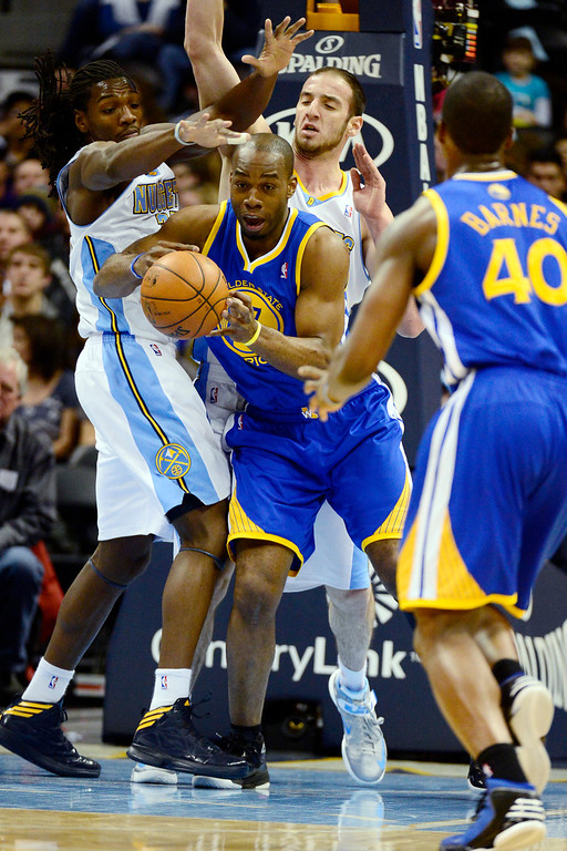 Description of . Golden State Warriors power forward Carl Landry (7) is pressured by Denver Nuggets center Kosta Koufos (41) and small forward Kenneth Faried (35) during the first half at the Pepsi Center on Sunday, January 13, 2013. AAron Ontiveroz, The Denver Post