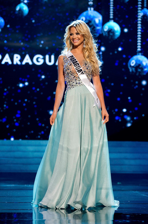 Description of . Miss Paraguay 2012 Egni Eckert competes in an evening gown of her choice during the Evening Gown Competition of the 2012 Miss Universe Presentation Show in Las Vegas, Nevada, December 13, 2012. The Miss Universe 2012 pageant will be held on December 19 at the Planet Hollywood Resort and Casino in Las Vegas. REUTERS/Darren Decker/Miss Universe Organization L.P/Handout