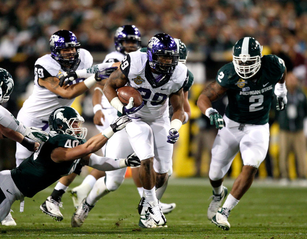Description of . TCU's Matthew Tucker (29) carries the ball during the first quarter of the Buffalo Wild Wings Bowl NCAA college football game against Michigan State at Sun Devil Stadium, Saturday, Dec. 29, 2012, in Tempe, Ariz. (AP Photo/The Arizona Republic )