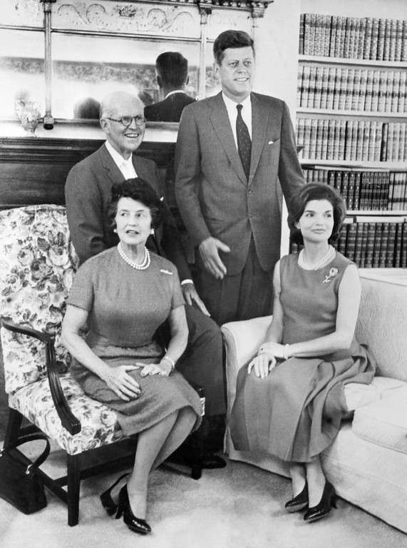 Description of . The first lady and president pose for a photo with his father and mother, Joseph Patrick Kennedy and Rose Fitzgerald Kennedy, at the White House in the early 1960s. AFP/Getty Images