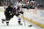 Teemu Selanne #8 of the Anaheim Ducks and Stefan Elliott #46 of the Colorado Avalanche race for the puck in the third period at Honda Center on February 24, 2013 in Anaheim, California. The Ducks defeated the Avalanche 4-3 in overtime.  (Photo by Jeff Gross/Getty Images)