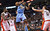 Denver Nuggets' Kenneth Faried (35) is fouled by Toronto Raptors' Amir Johnson, left, as Jonas Valanciunas defends during the first half of an NBA basketball game in Toronto on Tuesday, Feb. 12, 2013. (AP Photo/The Canadian Press, Chris Young)