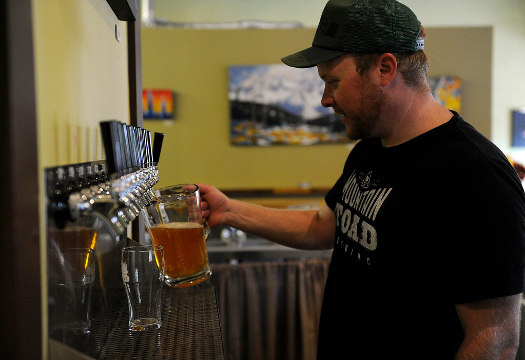 Description of . GOLDEN, CO - AUGUST 23: Matt Weatherbee pours a pitcher of beer at Mountain Toad Brewing on August 23, 2013, in Golden, Colorado. The brewery opened in May. (Photo by Anya Semenoff/YourHub)