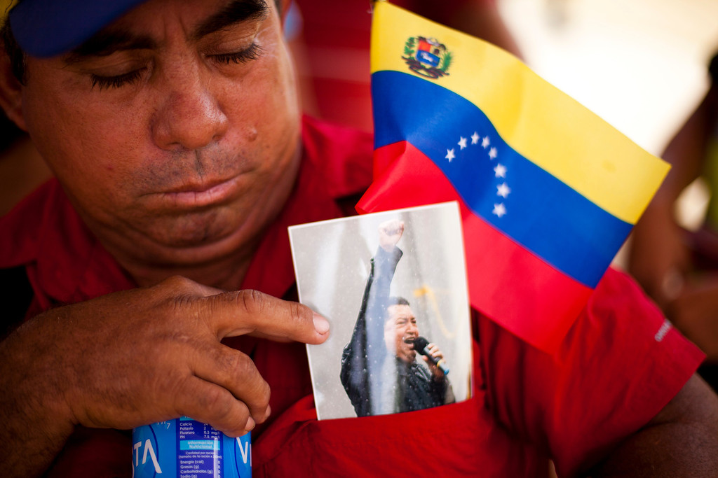 Description of . Supporters of late Venezuela's President Hugo Chavez await their turn to pay their last homage to their leader, in Caracas, on March 12, 2013. The campaign to succeed the late Hugo Chavez in Venezuela has officially begun. LEO RAMIREZ/AFP/Getty Images