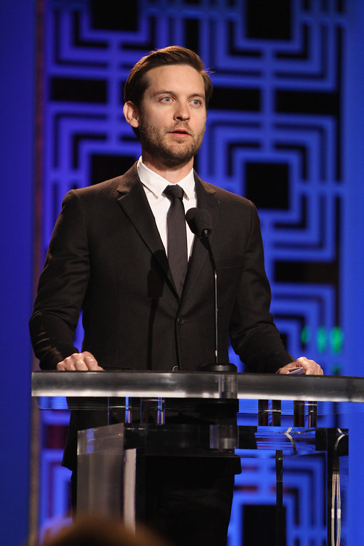 Description of . Actor Tobey Maguire speaks onstage during the 2013 WGAw Writers Guild Awards at JW Marriott Los Angeles at L.A. LIVE on February 17, 2013 in Los Angeles, California.  (Photo by Maury Phillips/Getty Images for WGAw)
