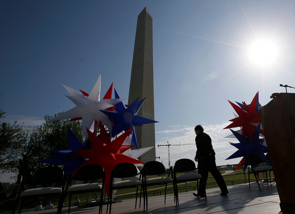 . Preparations continue on the stage at the Washington Monument in Washington, Monday, May 12, 2014, ahead of a ceremony to celebrate its re-opening. The monument, which sustained damage from an earthquake in August 2011, is reopening to the public today. (AP Photo)