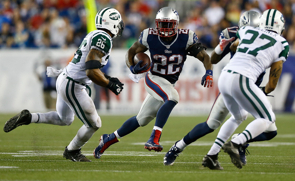 Description of . Stevan Ridley #22 of the New England Patriots carries the ball against the New York Jets during the game at Gillette Stadium on September 12, 2013 in Foxboro, Massachusetts. (Photo by Jared Wickerham/Getty Images)