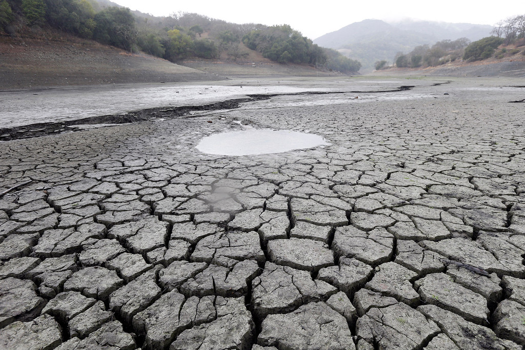 Description of . This Feb. 7, 2014, file photo shows the cracked-dry bed of the Almaden Reservoir in San Jose, Calif.     (AP Photo/Marcio Jose Sanchez, File)