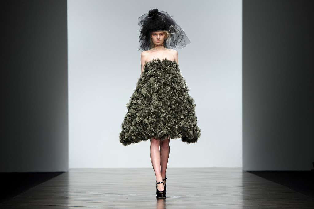 Description of . A model wears a design from the John Rocha collection during London Fashion Week, Saturday, Feb. 16, 2013, London. (Photo by Jonathan Short/Invision/AP)