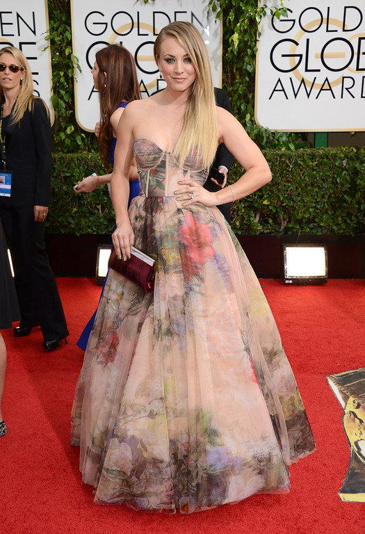 Description of . Kaley Cuoco arrives at the 71st annual Golden Globe Awards at the Beverly Hilton Hotel on Sunday, Jan. 12, 2014, in Beverly Hills, Calif. (Photo by Jordan Strauss/Invision/AP)