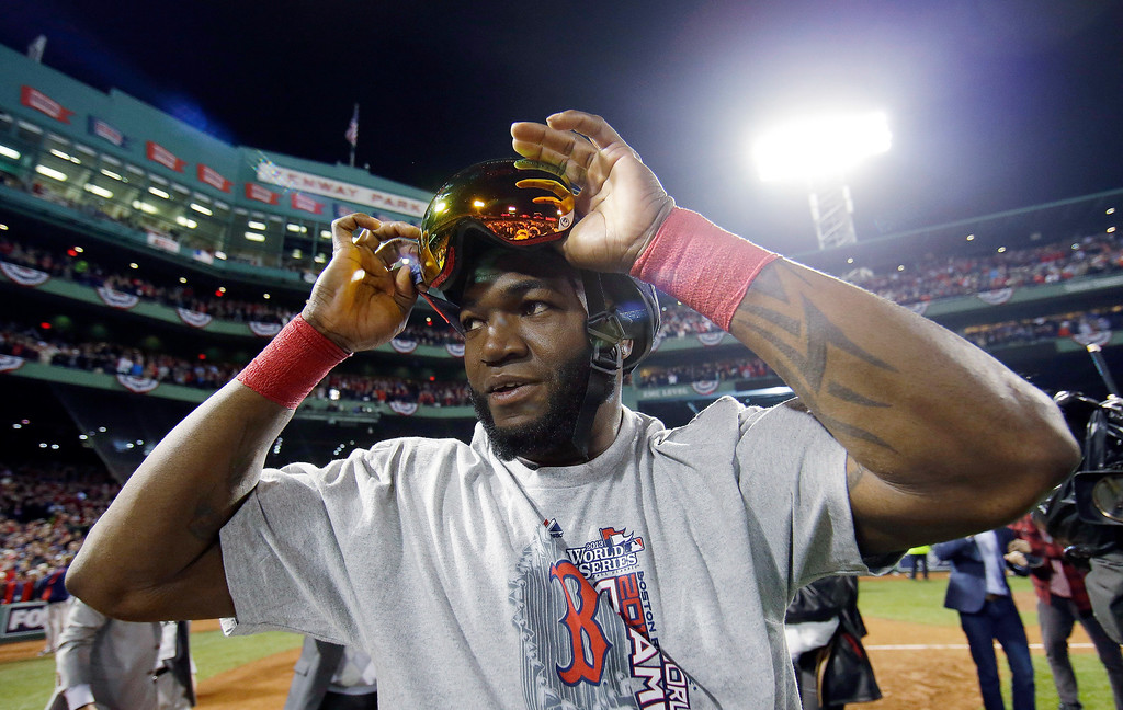 Description of . Boston Red Sox's David Ortiz adjust his goggles after Boston Red Sox defeated St. Louis Cardinals in Game 6 of baseball's World Series Wednesday, Oct. 30, 2013, in Boston. The Red Sox won 6-1 to win the series. (AP Photo/Matt Slocum)