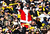 A fan dressed up as Santa Claus waves his Terrible Towel during the game between the Pittsburgh Steelers and the Cincinnati Bengals at Heinz Field on December 23, 2012 in Pittsburgh, Pennsylvania. (Photo by Jared Wickerham/Getty Images)