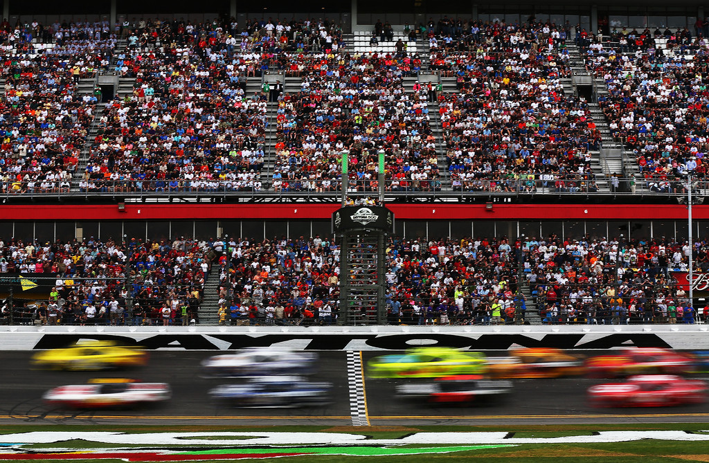 Description of . Fans watch cars race during the NASCAR Sprint Cup Series Daytona 500 at Daytona International Speedway on February 24, 2013 in Daytona Beach, Florida.  (Photo by Mike Ehrmann/Getty Images)
