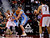 Toronto Raptors' DeMar DeRozan (L) passes the ball past Denver Nuggets' Timofey Mozgov to teammate Andrea Bargnani (R) during the first half of their NBA basketball game in Toronto February 12, 2013.  REUTERS/Jon Blacker