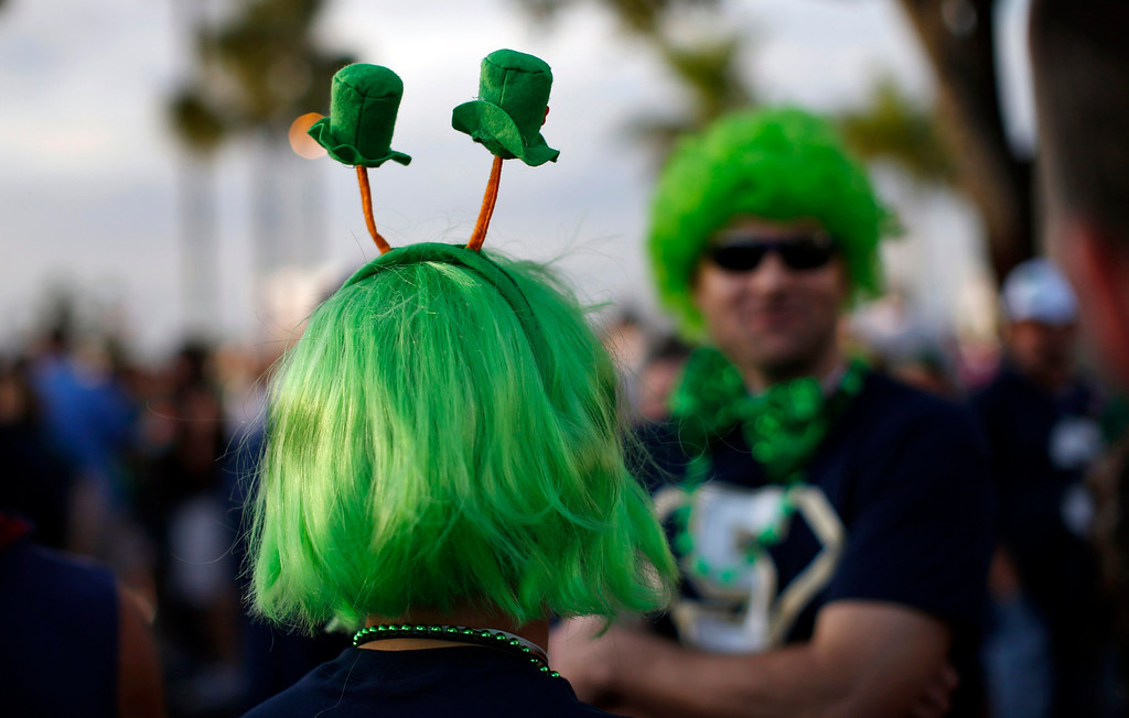 Description of . Notre Dame Fighting Irish fans dressed in costumes stand outside the Sun Life stadium before the BCS National Championship college football game between the Alabama Crimson Tide and the Notre Dame Fighting Irish in Miami, Florida January 7, 2013. REUTERS/Mike Segar