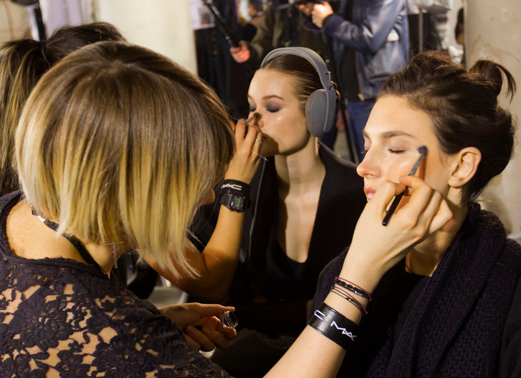 Description of . Make up artists prepare models before the Women's Spring/Summer 2013 Haute Couture fashion collection fashion show by French designer Alexandre Vauthier presented in Paris, Tuesday, Jan. 22 2013 (AP Photo/ Jacques Brinon)