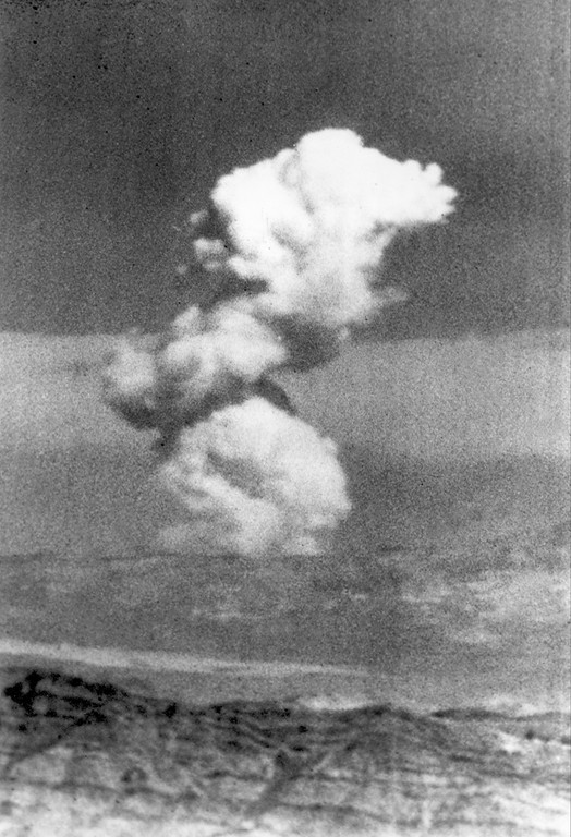 Description of . A mushroom cloud rises over the Nevada Test Site (NTS) after the U.S. Atomic Energy Commission (AEC) detonated a low-yield nuclear weapons effects test in Mercury, Nev., 65 miles northwest of Las Vegas, July 11, 1962.  The device fired underground at a depth shallow enough to form a crater.  (AP Photo)