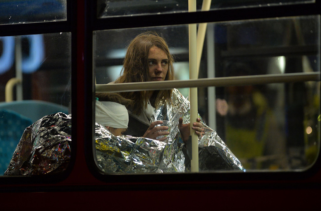 . Injured people sit wrapped in emergency blankets on a London bus used for casualties follwing a ceiling collapse at a theatre in Central London on December 19, 2013.   AFP PHOTO/LEON NEAL/AFP/Getty Images