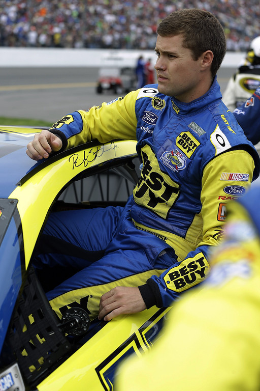 Description of . Ricky Stenhouse Jr. climbs in his car before the start of the NASCAR Daytona 500 Sprint Cup Series auto race at Daytona International Speedway, Sunday, Feb. 24, 2013, in Daytona Beach, Fla. (AP Photo/John Raoux)