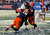 Siriki Diabate #18 of  and Cameron Lynch #38 of the Syracuse Orange sack Geno Smith #12 of the West Virginia Mountaineers in the New Era Pinstripe Bowl at Yankee Stadium on December 29, 2012 in the Bronx borough of New York City.  (Photo by Jeff Zelevansky/Getty Images)