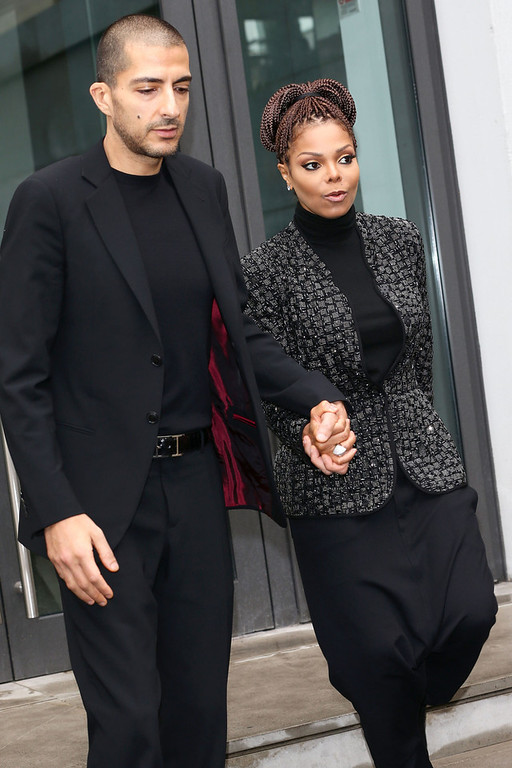 Description of . Wissam al Mana and Janet Jackson attend the Giorgio Armani fashion show as part of Milan Fashion Week Womenswear Fall/Winter 2013/14 on February 25, 2014 in Milan, Italy.  (Photo by Vittorio Zunino Celotto/Getty Images)