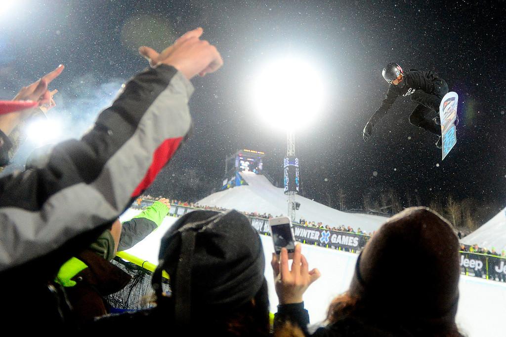 Description of . ASPEN, CO. - JANUARY 24: Shaun White makes a hit during the men's Snowboard Superpipe elimination. Men's Snowboard Slopestyle elimination X Games Aspen Buttermilk Mountain Aspen January 24, 2013 (Photo By AAron Ontiveroz / The Denver Post)