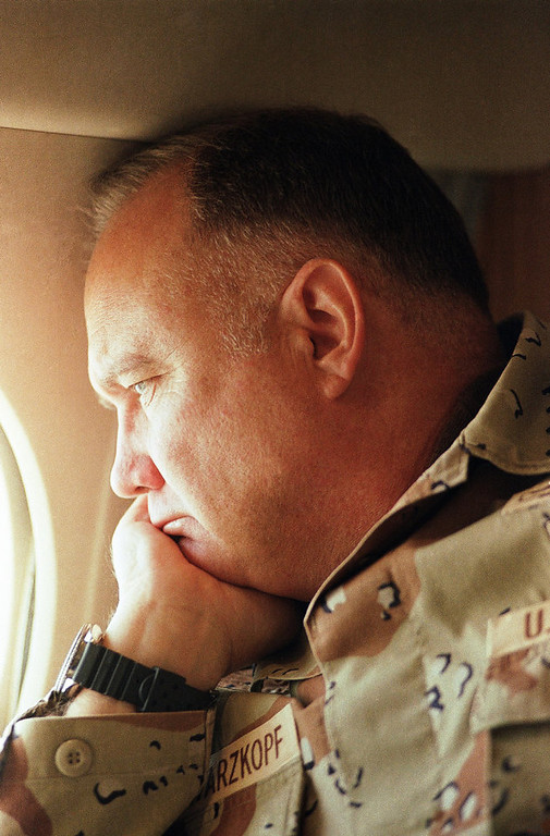 Description of . General H. Norman Schwarzkopf, commander of U.S. troops in the Gulf, gazes from the window of his small jet on his way out to visit U.S. troops in the desert on Saturday, Jan. 13, 1991 in Saudi Arabia. (AP Photo/Bob Daugherty)