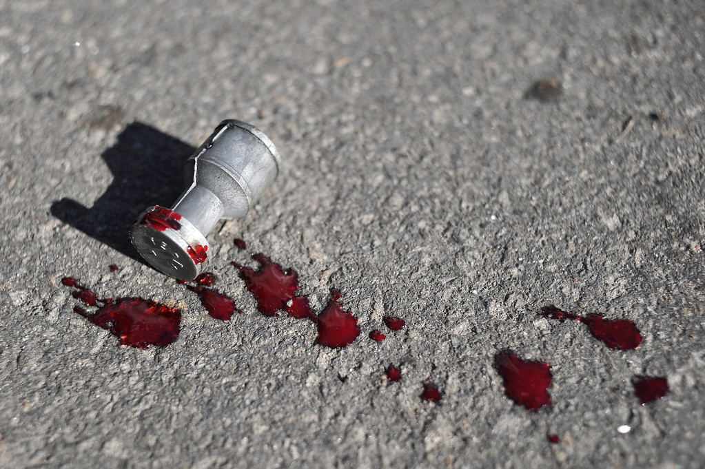 Description of . A bullet used by the riot police lies on the floor with blood on it during an anti-government protest in downtown Kiev, Ukraine, 18 February 2014.  EPA/ALEXEY FURMAN