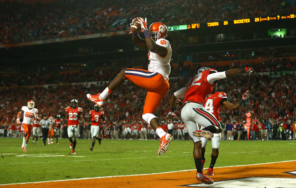 Description of . MIAMI GARDENS, FL - JANUARY 03:  Sammy Watkins #2 of the Clemson Tigers catches a touchdown in the third quarter against Doran Grant #12 of the Ohio State Buckeyes during the Discover Orange Bowl at Sun Life Stadium on January 3, 2014 in Miami Gardens, Florida.  (Photo by Streeter Lecka/Getty Images)