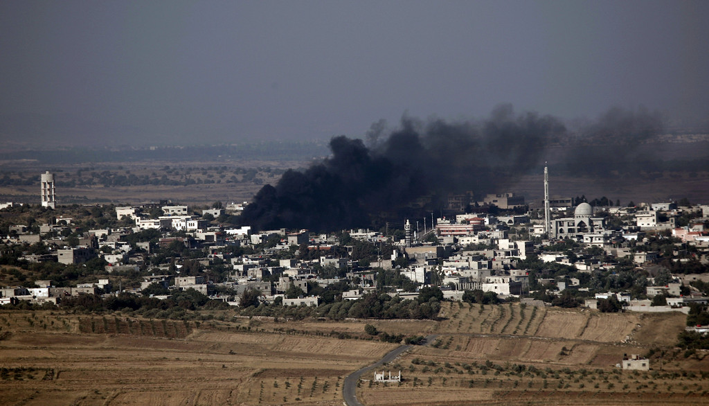 Description of . A picture taken from a village in the Israeli-annexed Golan Heights shows smoke billowing following alleged shelling by Syrian government forces in the southern Syrian village of Jubata al-Khashab on June 20, 2013. Syrian rebels urged friendly world powers to provide them with heavier weapons and to impose a no-fly zone over parts of the country they control to avert a humanitarian disaster.   JALAA MAREY/AFP/Getty Images