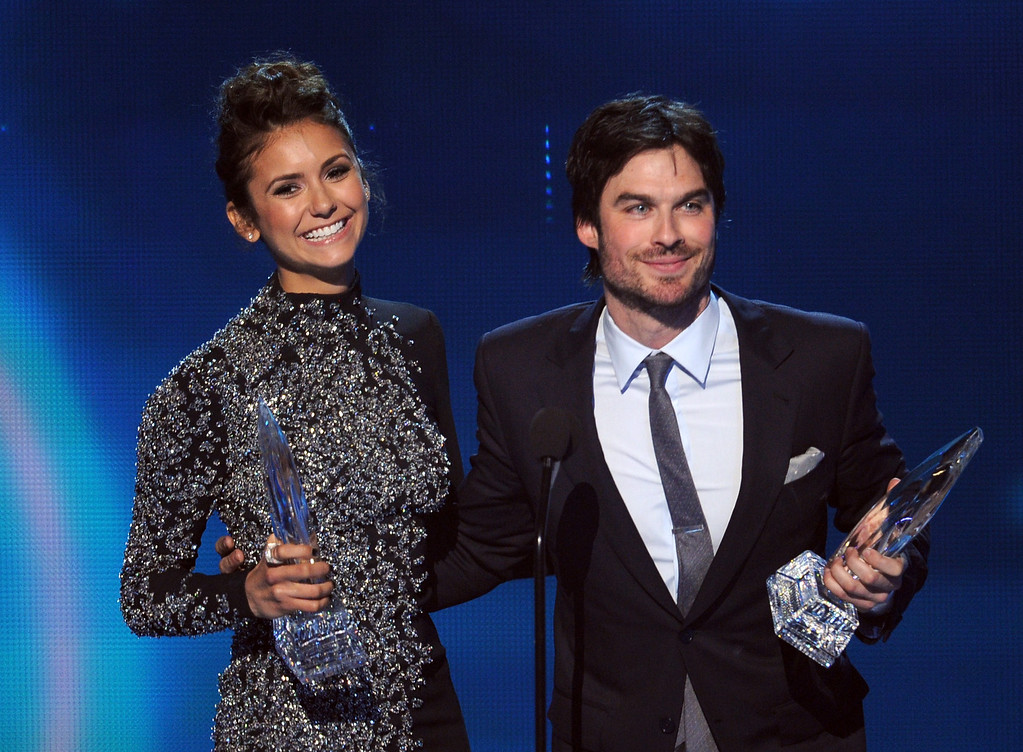 Description of . LOS ANGELES, CA - JANUARY 08:  Actors Nina Dobrev (L) and Ian Somerhalder, winners of the Favorite On Screen Chemistry award for