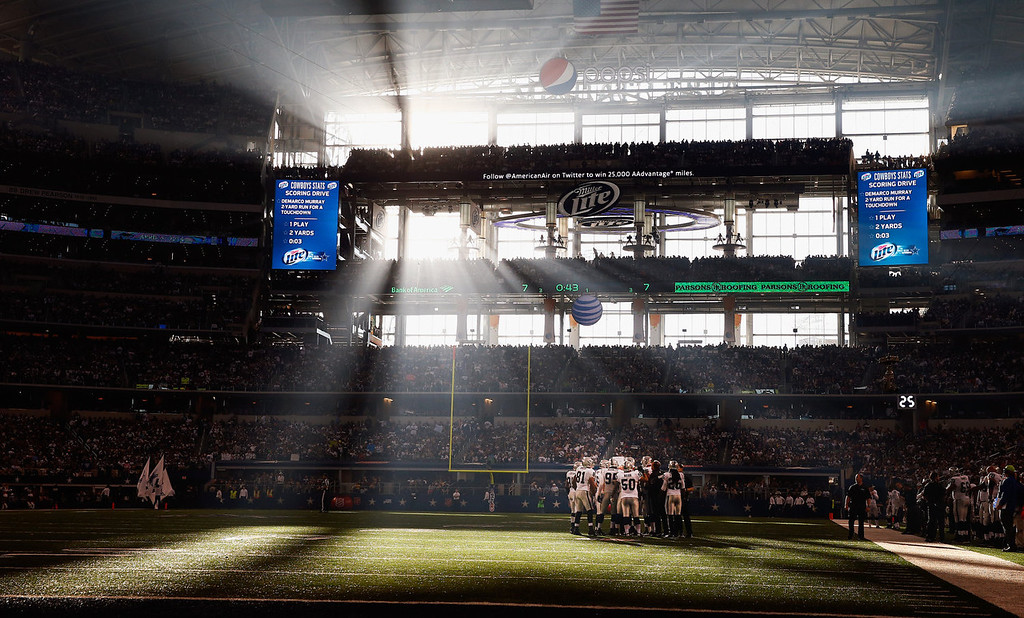 Description of . The Oakland Raiders huddle up against the Dallas Cowboys during a Thanksgiving Day game at AT&T Stadium on November 28, 2013 in Arlington, Texas.  (Photo by Tom Pennington/Getty Images)