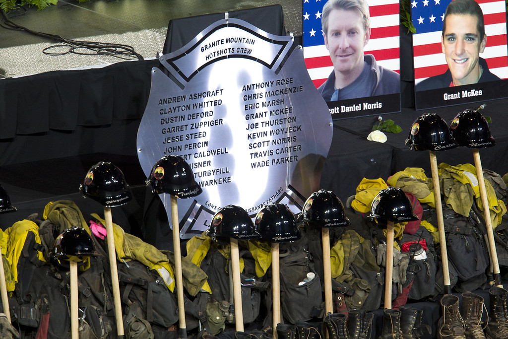 Description of . Memorabilla are displayed during a memorial service honoring 19 fallen firefighters at Tim's Toyota Center July 9, 2013 in Prescott Valley, Arizona.  (Photo by Michael Chow-Pool/Getty Images)
