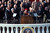 A distant view of Lyndon Johnson, shown taking the oath of office, during the inauguration ceremonies in front of the Capitol Building in Washington, D.C., on Jan. 20, 1965. Administering the oath is Chief Justice Earl Warren, right. Holding the bible at center is Lady Bird Johnson, beginning a new tradition. (AP Photo)