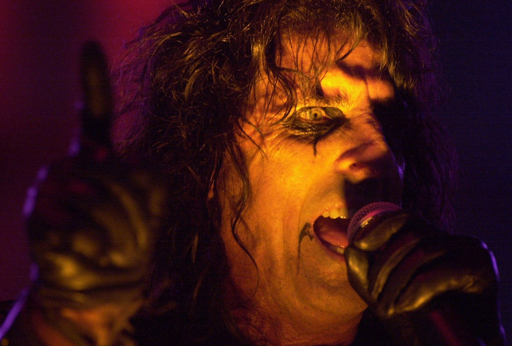 Description of . Vince Furnier, better known as Alice Cooper, performs at the Michigan State Fair in Detroit, Sunday, Sept. 3, 2000. Cooper, who is orignally from Detroit, plans to end the tour on Halloween Night in New York City. (AP Photo/Paul Warner)