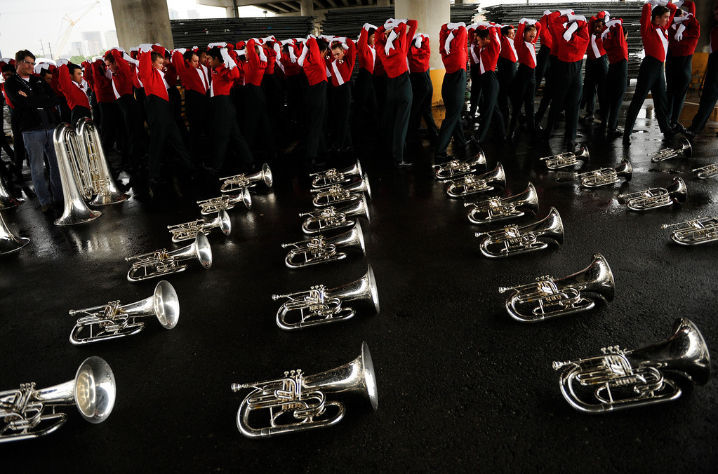 Description of . Musicians from the Santa Clara Vanguard corps warmed up beneath the Colfax Avenue viaduct Saturday night. Drums Along the Rockies drum and bugle corps organizers elected to hold an abbreviated version of the competition at Sport Authority Field at Mile High due to the rain Saturday night, July 7, 2012. Karl Gehring/The Denver Post