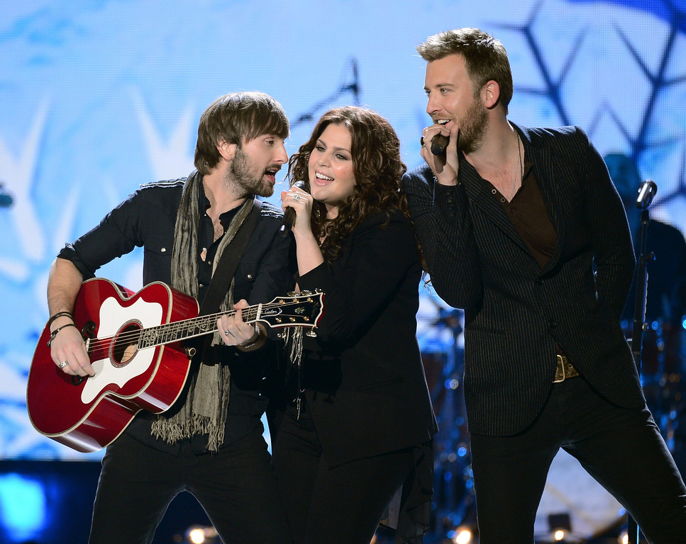 Description of . LAS VEGAS, NV - DECEMBER 10:  (L-R) Musicians Dave Haywood, Hillary Scott, and Charles Kelley of Lady Antebellum perform onstage during the 2012 American Country Awards at the Mandalay Bay Events Center on December 10, 2012 in Las Vegas, Nevada.  (Photo by Mark Davis/Getty Images)