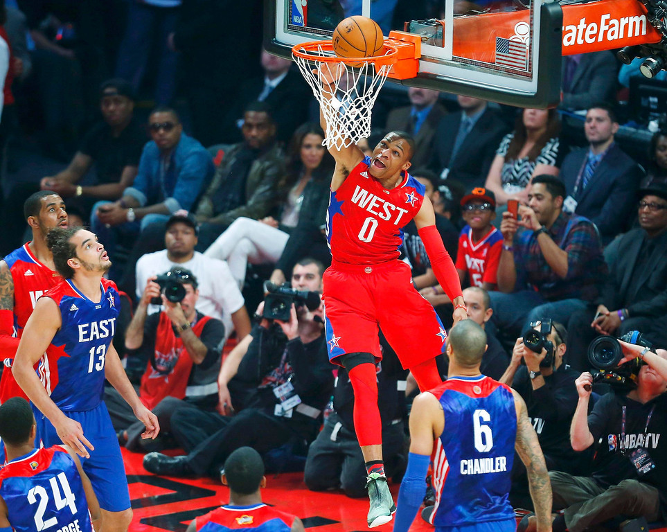 Description of . NBA All-Star Russell Westbrook of the Oklahoma Thunder (0) dunks during the 2013 NBA All-Star basketball game in Houston, Texas, February 17, 2013. REUTERS/Jeff Haynes