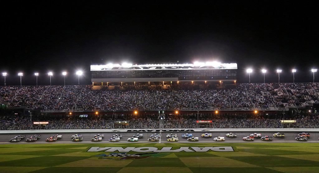 Description of . Pole-sitter Brennan Newberry, far left front, leads a group of trucks past the starting line to begin the NASCAR Truck Series auto race at Daytona International Speedway, Friday, Feb. 22, 2013, in Daytona Beach, Fla. (AP Photo/Chris O'Meara)